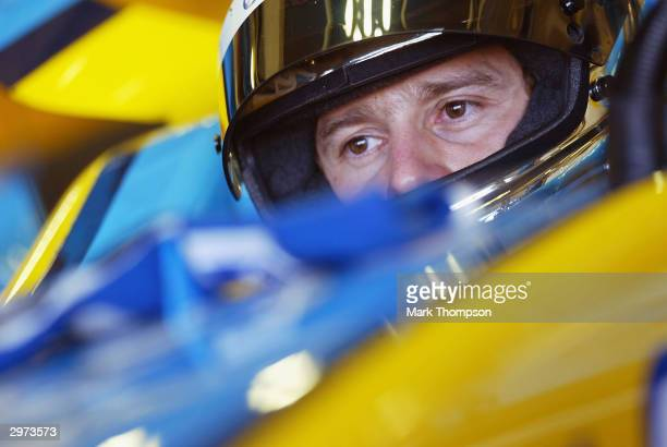 Jarno Trulli of Italy and Renault prepares to leave the garage during preseason Formula One Testing at the Circuito de Jerez on February 12 2004 in...