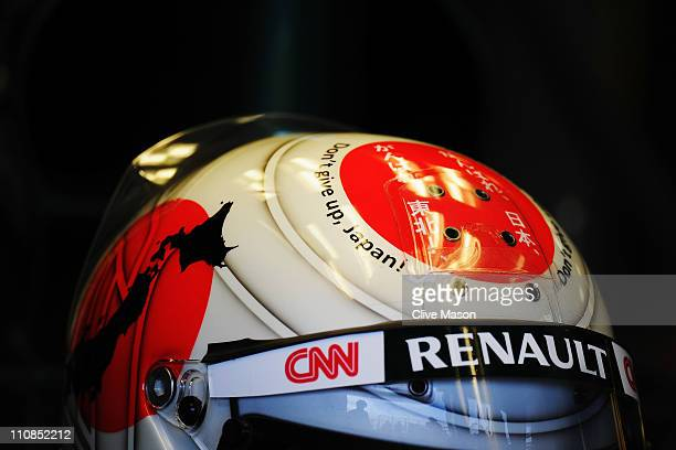 Jarno Trulli of Italy and Team Lotus shows support for the Japanese people on his drivers helmet during practice for the Australian Formula One Grand...