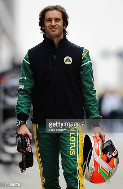 Jarno Trulli of Italy and Team Lotus walks in the pitlane before qualifying for the Chinese Formula One Grand Prix at the Shanghai International...