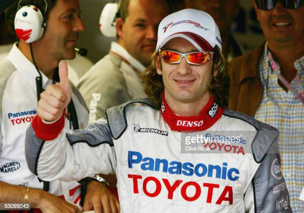 Jarno Trulli of Italy and Toyota celebrates his pole position after qualifying for the United States F1 Grand Prix at the Indianapolis Motor Speedway...