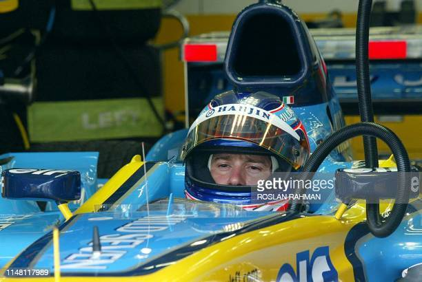 Jarno Trulli of Italy prepares for a practice session in preparation for this weekend's Malaysian Grand Prix in Sepang 21 March 2003 Trulli finished...