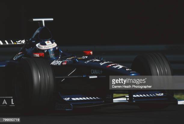 Jarno Trullii of Italy drives the Gauloises Prost PeugeotProst AP01 Peugeot A16 V10 during the Formula One German Grand Prix on 2 August 1998 at the...