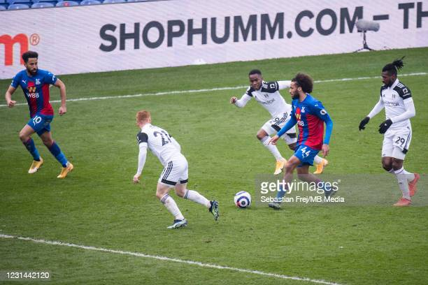 Jaïro Riedewald and Andros Townsend of Crystal Palace and Ademola Lookman, André-Frank Zambo Anguissa, Harrsison Reed of Fulham in action during the...