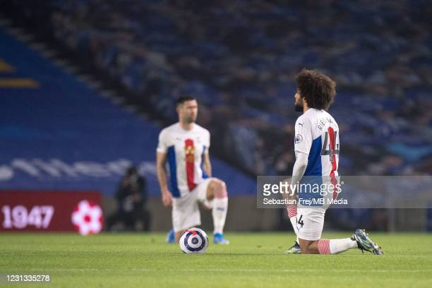 Jaïro Riedewald of Crystal Palace take a knee during the Premier League match between Brighton & Hove Albion and Crystal Palace at American Express...