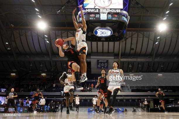 Jarod Lucas of the Oregon State Beavers shoots against Avery Anderson III of the Oklahoma State Cowboys during the first half in the second round...