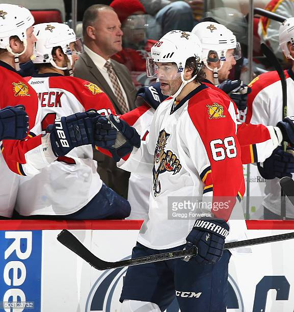 Jarolmir Jagr of the Florida Panthers celebrates with teammates after a score against the Carolina Hurricanes during a NHL game at PNC Arena on...