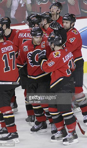 Jarome Iginla and Matthew Lombardi of the Calgary Flames celebrate with teammates after their win over the Anaheim Mighty Ducks in game five of the...