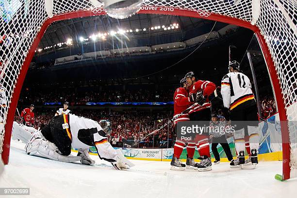 Jarome Iginla of Canada celebrates with his team after scoring a goal past Thomas Greiss of Germany in the second period during the ice hockey Men's...