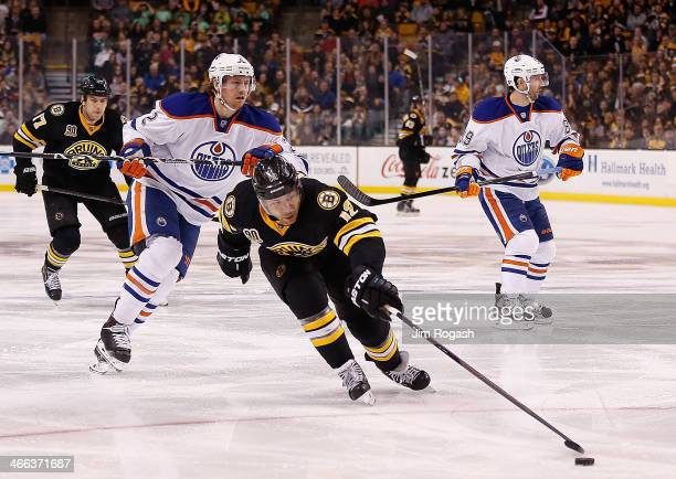 Jarome Iginla of the Boston Bruins beats Jeff Petry of the Edmonton Oilers to the puck in the 2nd period at TD Garden on February 1 2014 in Boston...
