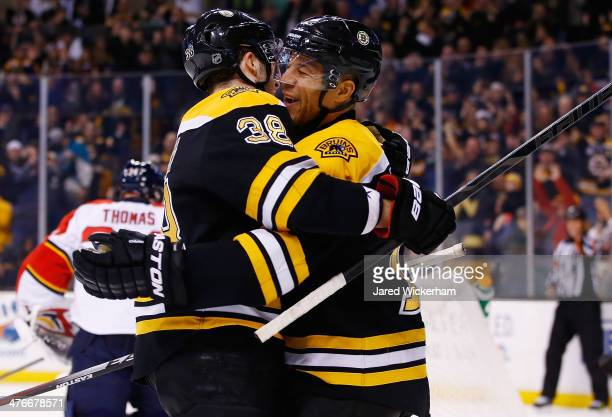 Jarome Iginla of the Boston Bruins celebrates with teammate Jordan Caron following his goal in the first period against the Florida Panthers during...