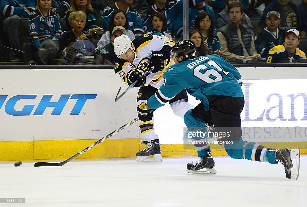 Jarome Iginla #12 of the Boston Bruins gets his shot off, past Justin Braun #61 of the San Jose Sharks during the first period at SAP Center on January 11, 2014 in San Jose, California.