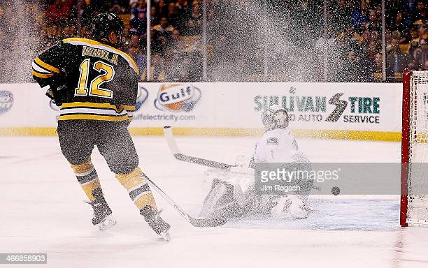 Jarome Iginla of the Boston Bruins presses as a goal by teammate Milan Lucic slips by Roberto Luongo of the Vancouver Canucks in the first period...