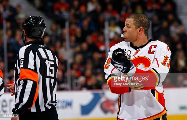 Jarome Iginla of the Calgary Flames adjusts his elbow pads after a skirmish with the Ottawa Senators in a game at Scotiabank Place on February 9 2010...