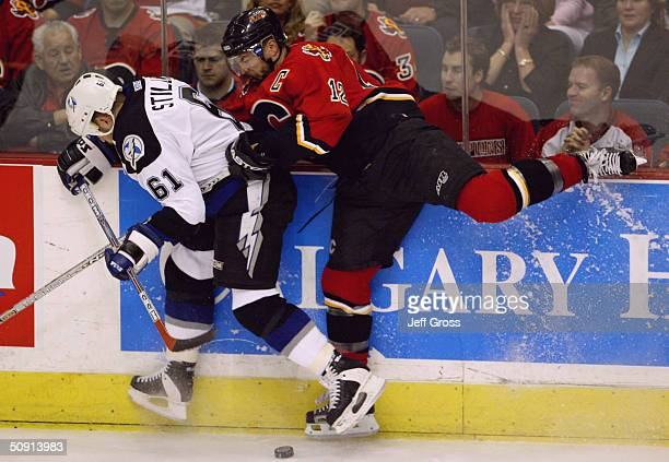 Jarome Iginla of the Calgary Flames and Cory Stillman of the Tampa Bay Lightning battle for the puck in game four of the NHL Stanley Cup Finals on...