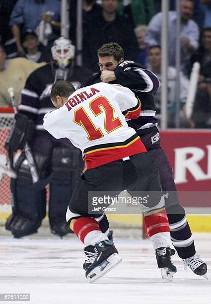 Jarome Iginla of the Calgary Flames and Francois Beauchemin of the Mighty Ducks of Anaheim fight during the first period of game six of the Western...