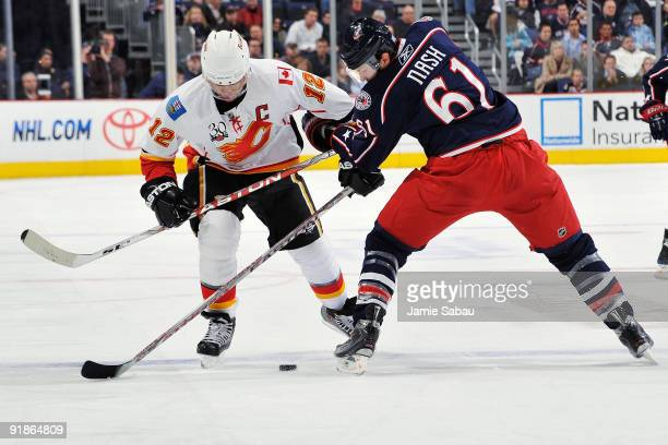 Jarome Iginla of the Calgary Flames attempts to skate the puck past Rick Nash of the Columbus Blue Jackets on October 13 2009 at Nationwide Arena in...