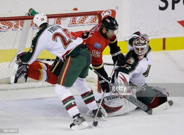 Jarome Iginla of the Calgary Flames crashes the net against the Minnesota Wild on November 13, 2007 at Pengrowth Saddledome in Calgary, Alberta,...