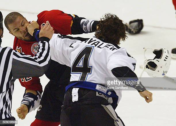 Jarome Iginla of the Calgary Flames gets into a fight with Vincent Lecavalier of the Tampa Bay Lightning in game three of the NHL Stanley Cup Finals...