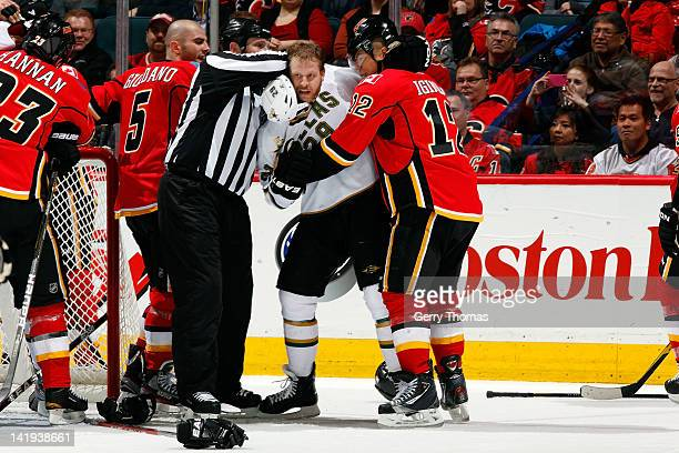 Jarome Iginla of the Calgary Flames gets into a post whistle altercation against Steve Ott of the Dallas Stars on March 26, 2012 at the Scotiabank...