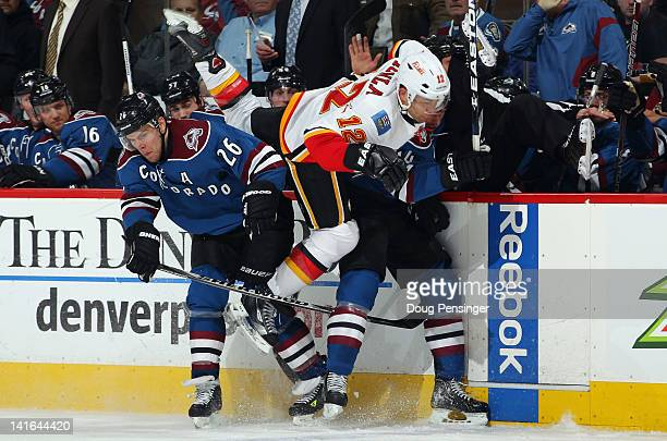 Jarome Iginla of the Calgary Flames is double teamed as Paul Stastny and Ryan Wilson of the Colorado Avalanche put on the squeeze at Pepsi Center on...