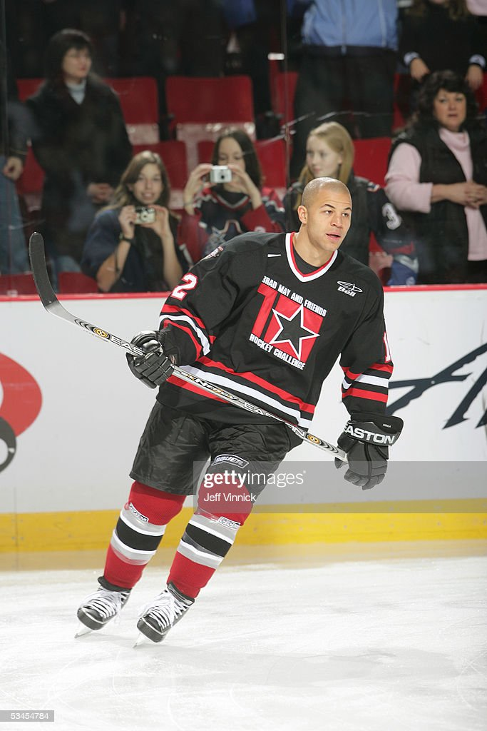 Jarome Iginla #12 of the Calgary Flames looks on during the Brad May and Friends Hockey Challenge at the Pacific Coliseum on December 12, 2004 in Vancouver, Canada. Players from the NHL and the WHL Vancouver Giants played two exhibition games to raise money for Canuck Place hospice in Vancouver.