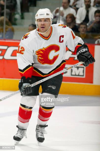 Jarome Iginla of the Calgary Flames looks on during the game against the Vancouver Canucks in the first round of the 2004 NHL Stanley Cup Playoffs at...