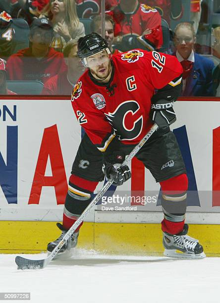 Jarome Iginla of the Calgary Flames looks to make a pass against the Tampa Bay Lightning in Game Four of the NHL Stanley Cup Finals on May 31 2004 at...