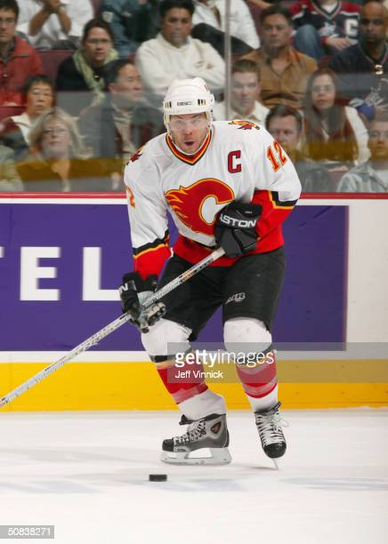 Jarome Iginla of the Calgary Flames looks to make a play during the game against the Vancouver Canucks in the first round of the 2004 NHL Stanley Cup...