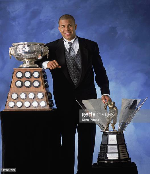 "Jarome Iginla of the Calgary Flames poses with the Art Ross Trophy and the Maurice ""Rocket"" Richard Trophy during the NHL Awards in the John Bassett..."