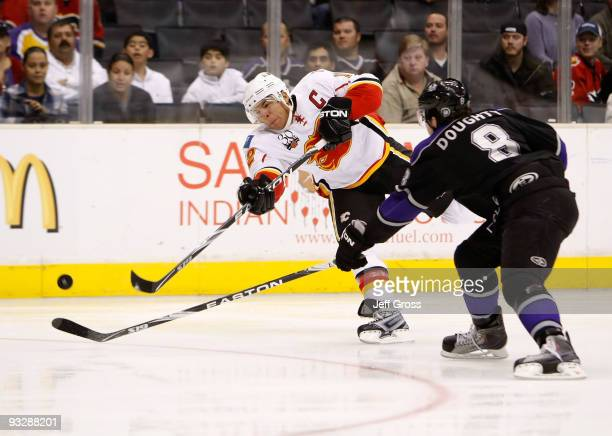 Jarome Iginla of the Calgary Flames shoots the puck past Drew Doughty of the Los Angeles Kings in the first period at Staples Center on November 21...