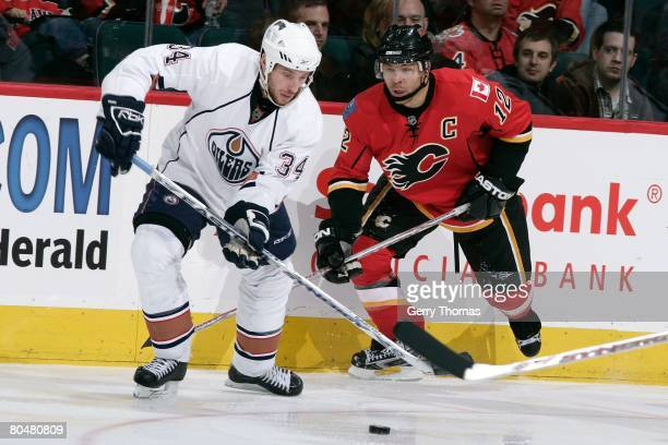 Jarome Iginla of the Calgary Flames skates against Fernando Pisani of the Edmonton Oilers on March 29 2008 at Pengrowth Saddledome in Calgary Alberta...
