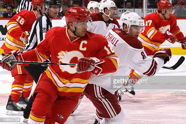 Jarome Iginla of the Calgary Flames skates against Scottie Upshall of the Phoenix Coyotes on November 17 2010 at the Scotiabank Saddledome in Calgary...