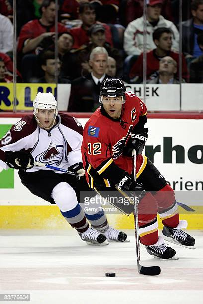 Jarome Iginla of the Calgary Flames skates against Tyler Arnason of the Colorado Avalanche on October 14, 2008 at Pengrowth Saddledome in Calgary,...