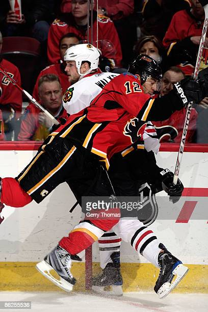 Jarome Iginla of the Calgary Flames skates into Matt Walker of the Chicago Blackhawks during Game Six of the Western Conference Quarterfinal Round of...