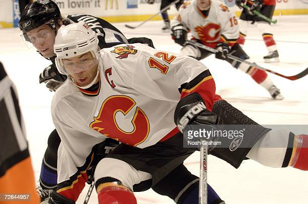 Jarome Iginla of the Calgary Flames skates with the puck against Alexander Frolov of the Los Angeles Kings on November 25 2006 at the Staples Center...