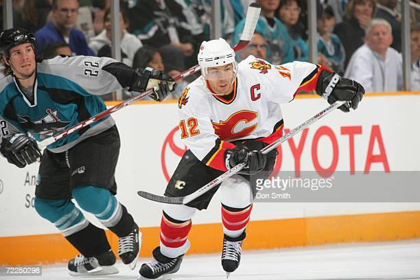 Jarome Iginla of the Calgary Flames skates with the puck during a preseason game against the San Jose Sharks on September 30 2006 at the HP Pavilion...
