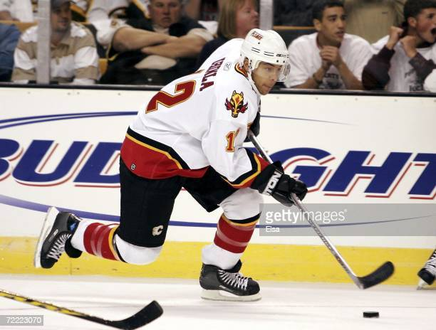 Jarome Iginla of the Calgary Flames takes the puck against the Boston Bruins during the home opener on October 19 2006 at TD Banknorth Garden in...