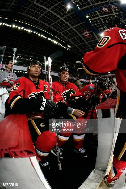 Jarome Iginla of the Calgary Flames watches the game from the bench in between shifts against the Toronto Maple Leafs on November 11, 2008 at...