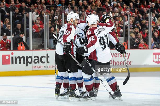 Jarome Iginla of the Colorado Avalanche celebrates with teammates after the Avalanche scored against the Chicago Blackhawks in the third period...