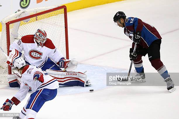 Jarome Iginla of the Colorado Avalanche collects the puck to score the game winning goal against goalie Ben Scrivens of the Montreal Canadiens in the...