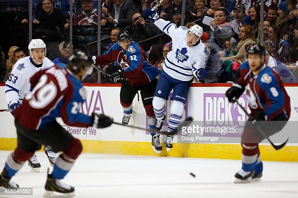 Jarome Iginla of the Colorado Avalanche puts a hit on James van Riemsdyk of the Toronto Maple Leafs during the first period of action at Pepsi Center...