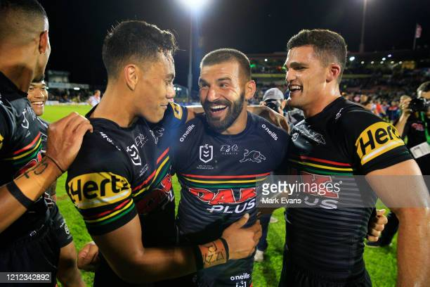 Jarome Luai Josh Mansour and Nathan Cleary of the Panthers celebrate their win after the round 1 NRL match between the Penrith Panthers and the...
