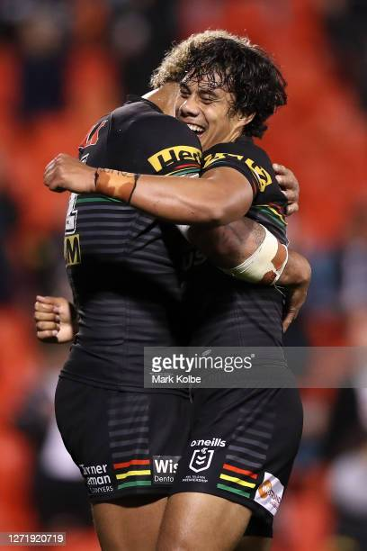 Jarome Luai of the Panthers and Viliame Kikau of the Panthers embrace after winning the round 18 NRL match between the Penrith Panthers and the...