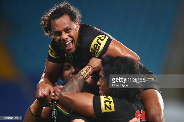 Jarome Luai of the Panthers celebrates a try by team mate Matt Burton of the Panthers during the round 25 NRL match between the Parramatta Eels and...
