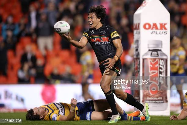 Jerome Luai of the Panthers celebrates scoring a try during the round 18 NRL match between the Penrith Panthers and the Parramatta Eels at Panthers...