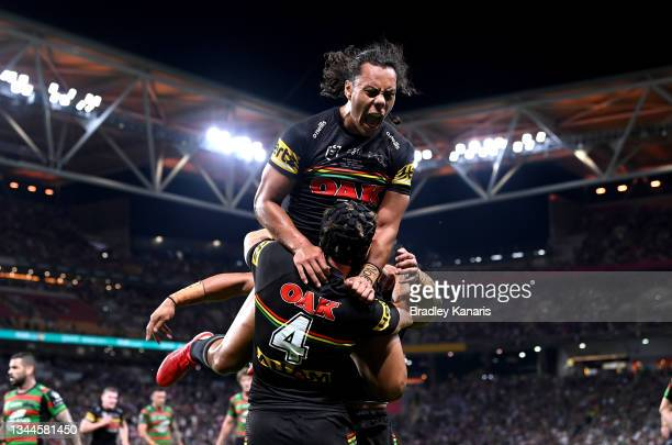Jarome Luai of the Panthers celebrates with Matt Burton of the Panthers after he scored a try during the 2021 NRL Grand Final match between the...