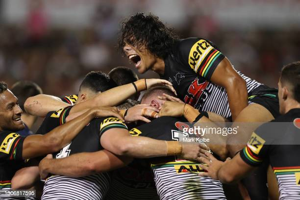 Jarome Luai of the Panthers celebrates with try-scorer Kurt Capewell of the Panthers during the round one NRL match between the Penrith Panthers and...