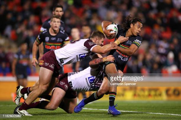 Jarome Luai of the Panthers is tackled during the round 12 NRL match between the Penrith Panthers and the Manly Warringah Sea Eagles at Panthers...