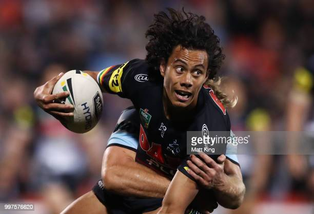 Jarome Luai of the Panthers is tackled during the round 18 NRL match between the Panthers and the Sharks at Panthers Stadium on July 13 2018 in...