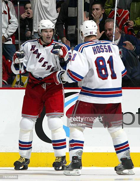 Jaromir Jagr and Marcel Hossa of the New York Rangers celebrate Jagr's 611th career goal which put him ahead of Bobby Hull into 13th place on the...